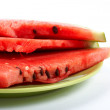 Watermelon slices on the green plate — Stockfoto