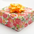 Gift box with yellow ribbon, on white background — ストック写真