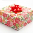 Gift box with red ribbon, on white background — Stock Photo