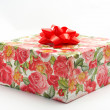 Gift box with red ribbon — Stock Photo