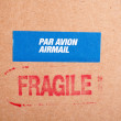 Fragile on cardboard box,  and sticker - Stock Photo