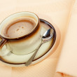 Close-up of a cup of coffee with the spoon - Stock Photo