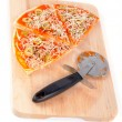 Slices of Italian pizza and cutter.  Macro shot on white background — ストック写真