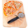 Slices of Italian pizza and cutter. Macro shot on white background — Stock Photo #6347797