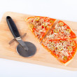 Slices of Italian pizza and cutter — Stock Photo