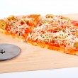 Detail of slices Italian pizza and cutter — Foto de Stock