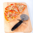 Slices of Italian pizza and cutter — Stock Photo #6347806
