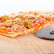 Detail of slices Italian pizza and cutter — ストック写真