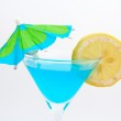 Detail of blue cocktail with lemon and umbrella — Stock Photo
