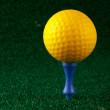 Yellow golfball and blue tee — Stock Photo #6348009