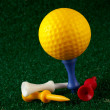 Yellow golfball and tees — Stock Photo