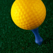 Yellow golfball and blue tee — Stock Photo #6348012