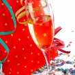 Foto Stock: Champagne glass with red shopping bag