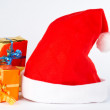 Detail of christmas hat and two gifts — Stock Photo