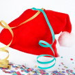 Christmas hat with ribbons and confetti — Stock Photo
