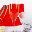 Champagne glass and christmas hat, with ribbons, confetti — Stock Photo