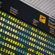 Departures board at airport — Stock Photo