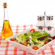 Oil bottle, green salad, salt and pepper — Stock Photo