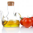 Tomatoes and oilcan — Stock Photo