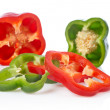 Stock Photo: Green and red pepper slices