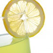Lemon juice with a slice — Stock Photo