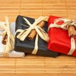 Three gifts on bamboo mat — Stock Photo #6348833