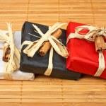 Three gifts on bamboo mat — Stock Photo