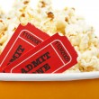 Detail of tickets and popcorn - Stock Photo
