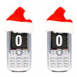 Stock Photo: Four Christmas cellular mobile phones