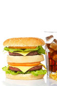 Double cheeseburger and soda glass — Stock Photo