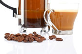 Cup and coffee pot and beans — Stock Photo