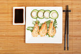Plate of prawns with soy sauce — Stock Photo