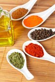 Spices and oil bottle — Stock Photo