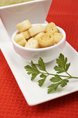 Bread croutons, parsley and spinach puree — Stock Photo