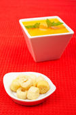 Bread croutons and carrots puree — Stock Photo