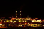 Night view of a petrochemical refinery — Stok fotoğraf
