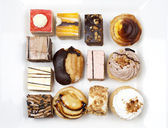 Assortment of delicious cakes — Stock Photo