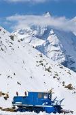 Snowplow in alpine road — Stock Photo