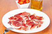 Skivor spansk skinka — Stockfoto