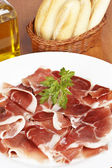 Slices of spanish ham — Stock Photo