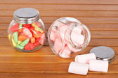 Colorful candies and pink marshmallows — Stock Photo