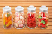 Glass jars of candies — Stockfoto
