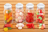 Glass jars of candies — Stock Photo