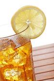 Glass of ice tea with lemon — Stock Photo