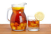 Ice tea with lemon pitcher — Stock Photo