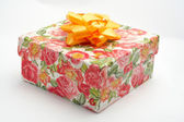 Gift box with yellow ribbon, on white background — Stock Photo