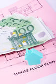 House and money on home plan — Stock Photo