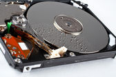 Opened hard disk drive, with water drops — Stock Photo