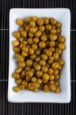 Peas on bamboo mat — ストック写真
