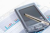 PDA on market financial chart background — Stock Photo